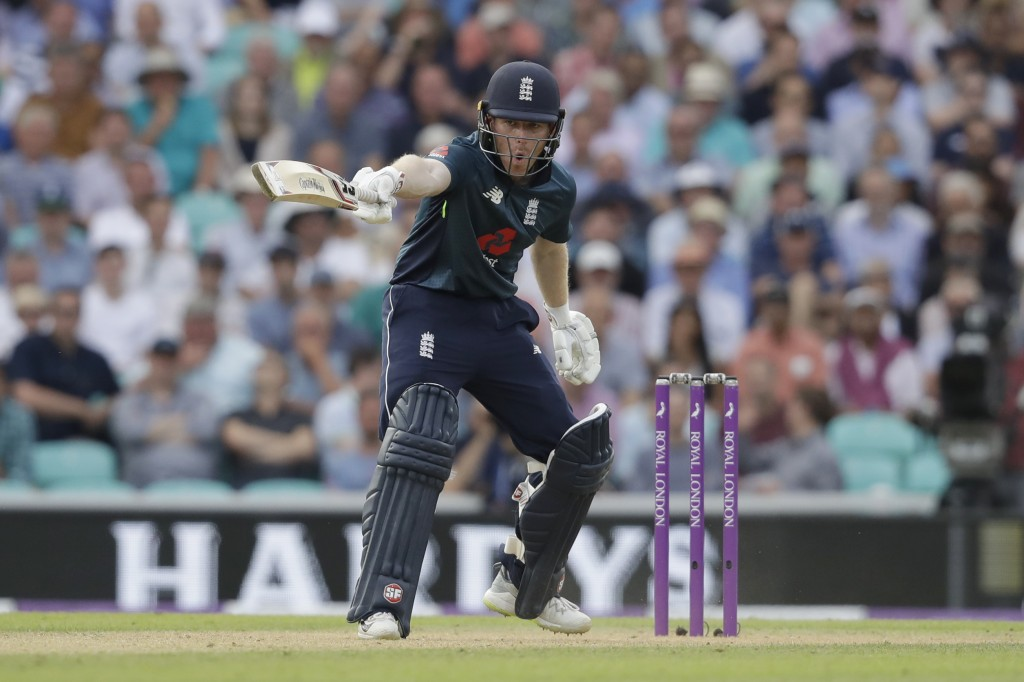 England captain Eoin Morgan shouts to his batting partner Joe Root not to run during the one-day cricket match between England and Australia at the Ov