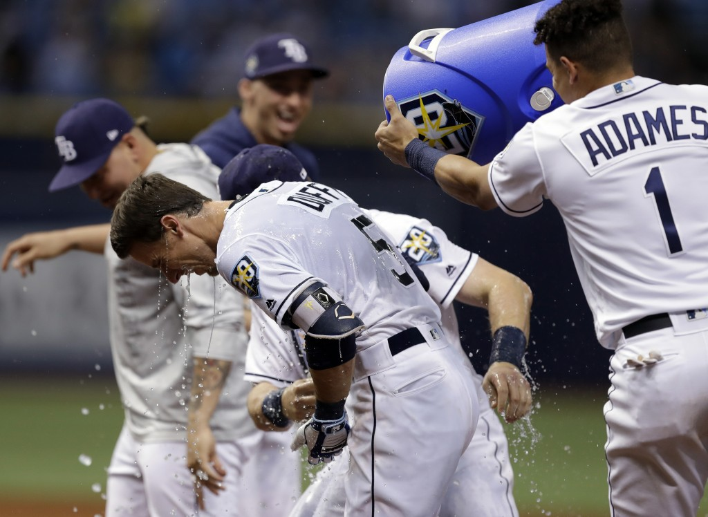 Tampa Bay Rays' Matt Duffy (5) gets doused with water by Willy Adames (1) after hitting the game-winning RBI single off Toronto Blue Jays relief pitch