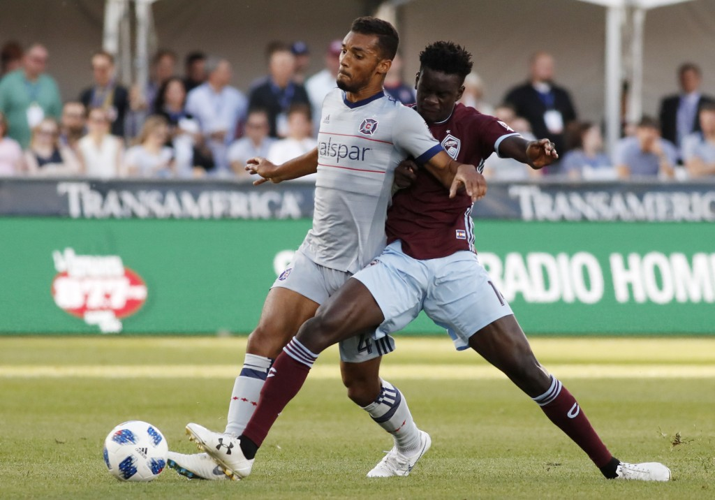 Colorado Rapids forward Dominique Badji, right, competes for control of the ball with Chicago Fire defender Johan Kappelhof during the first half of a