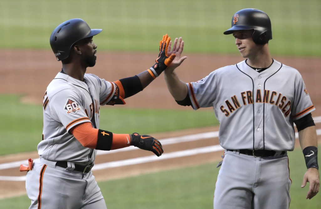 San Francisco Giants' Buster Posey, right, greets Andrew McCutchen after they scored on a home run by McCutchen during the first inning of a baseball