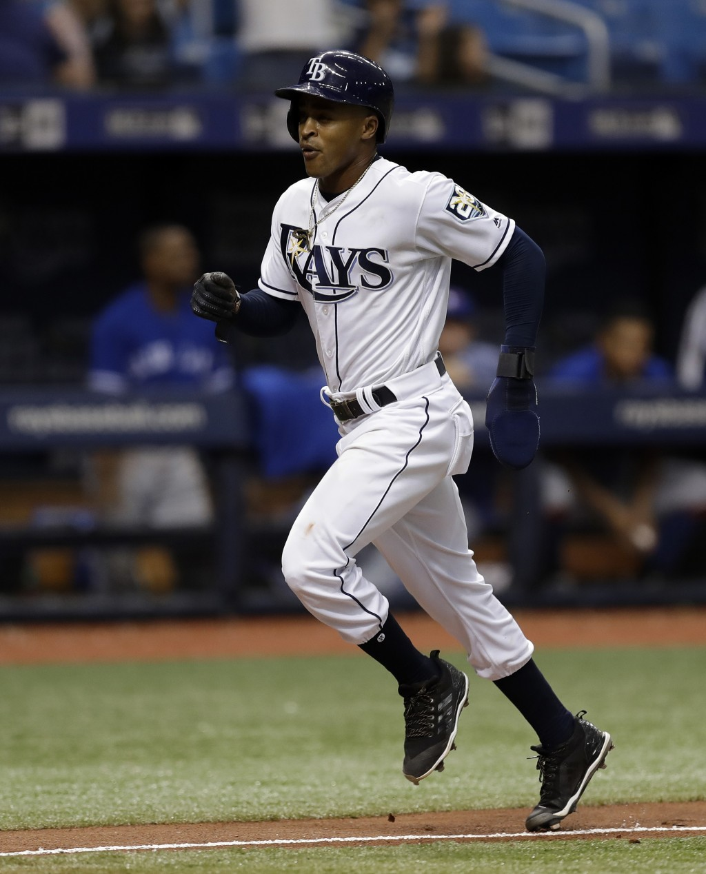 Tampa Bay Rays' Mallex Smith scores the game-winning run on an RBI single by Matt Duffy off Toronto Blue Jays relief pitcher Ryan Tepera during the ni...