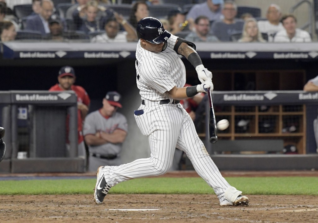 New York Yankees' Gleyber Torres hits a home run during the fifth inning of a baseball game against the Washington Nationals on Wednesday, June 13, 20