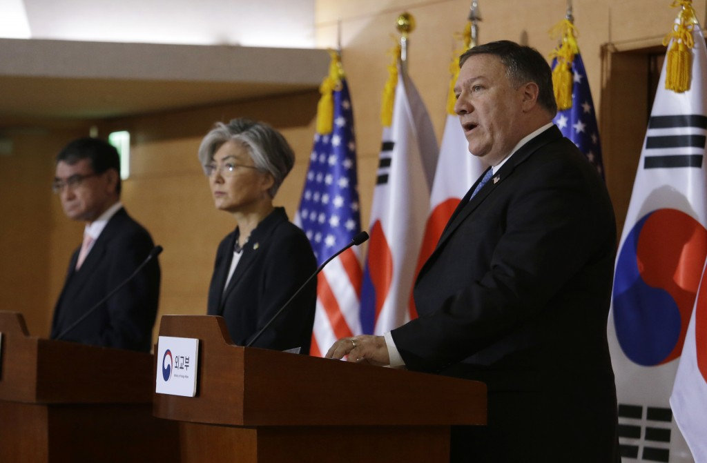 U.S. Secretary of State Mike Pompeo, right, speaks as South Korean Foreign Minister Kang Kyung-wha, center, and Japanese Foreign Minister Taro Kono li...
