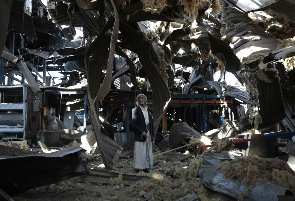 FILE - In this Sept. 22, 2016, file photo, an elderly man stands among the rubble of the Alsonidar Group's water pump and pipe factory after it was hi