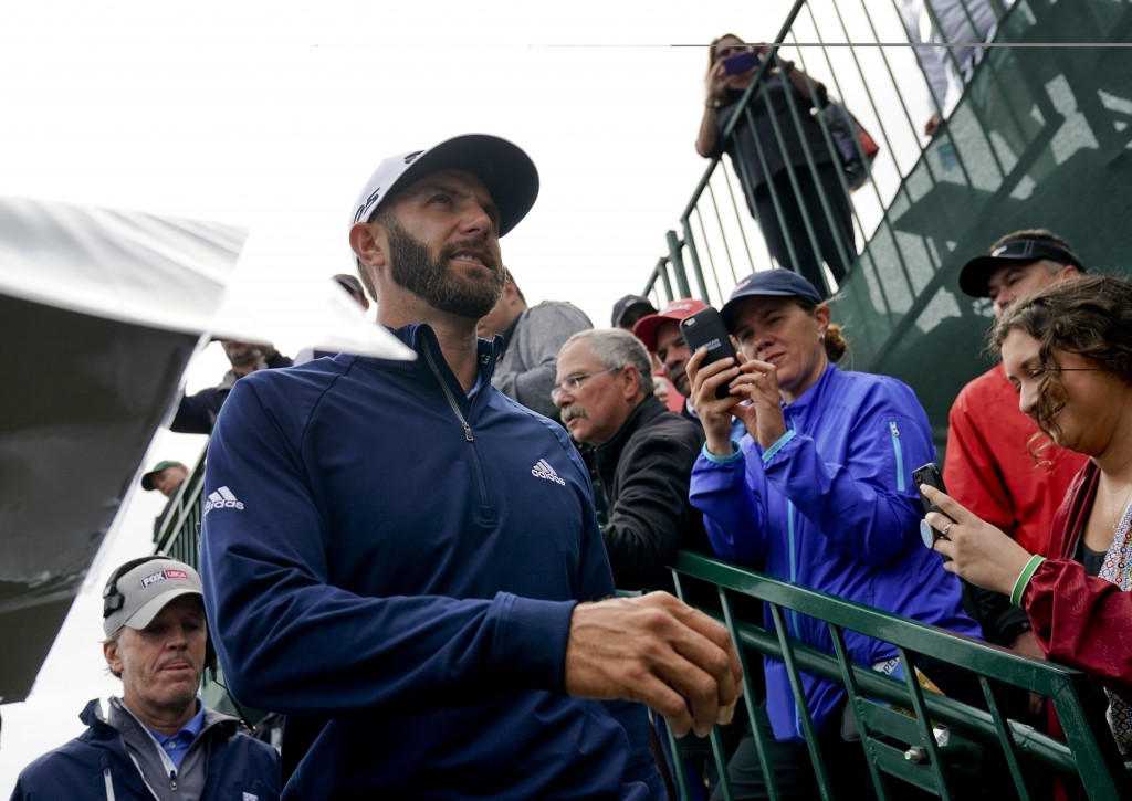 Dustin Johnson heads for the 14th tee during a practice round for the U.S. Open Golf Championship, Wednesday, June 13, 2018, in Southampton, N.Y. (AP