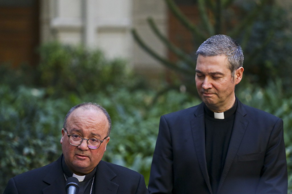 Archbishop Charles Scicluna, left, and Spanish Monsignor Jordi Bertomeuof, right, take part in a press conference at the Catholic University of Chile,