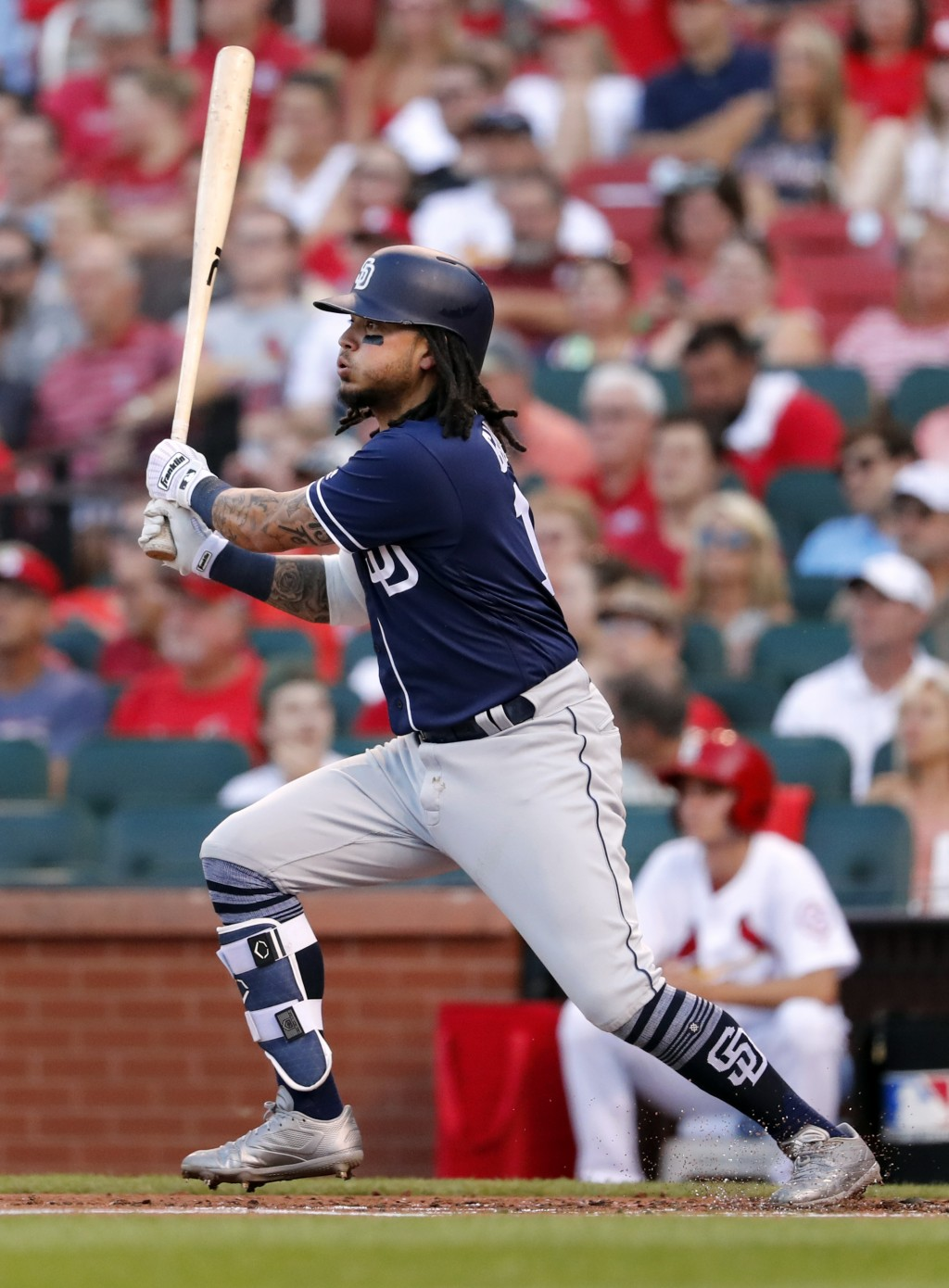 San Diego Padres' Freddy Galvis watches his two-run double during the first inning of a baseball game against the St. Louis Cardinals on Wednesday, Ju