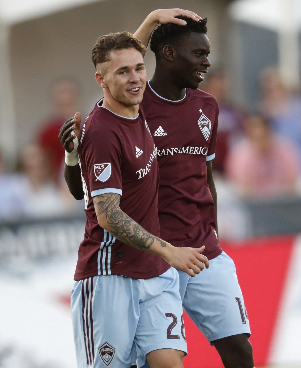 Colorado Rapids midfielder Sam Nicholson, front, congratulates forward Dominique Badji for his goal against the Chicago Fire during the first half of