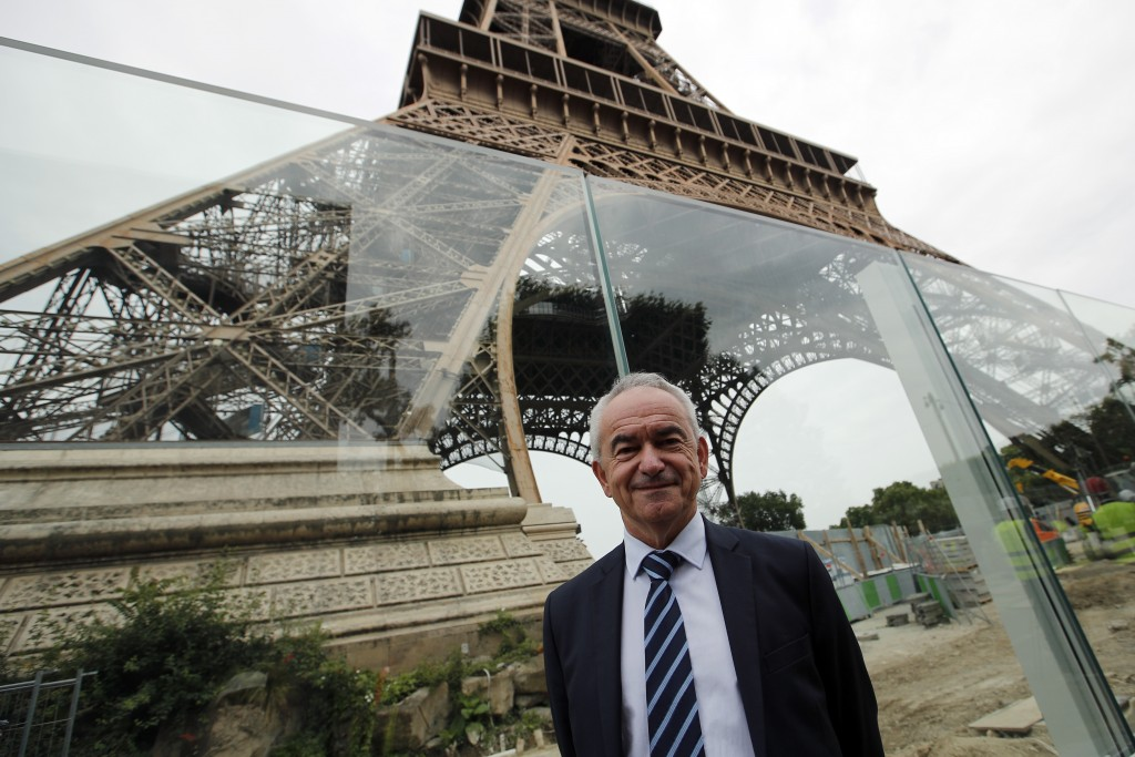 Bernard Gaudillere, president of the SETE, Eiffel Tower Exploitation Society poses in front of a new security bulletproof glass barrier under construc