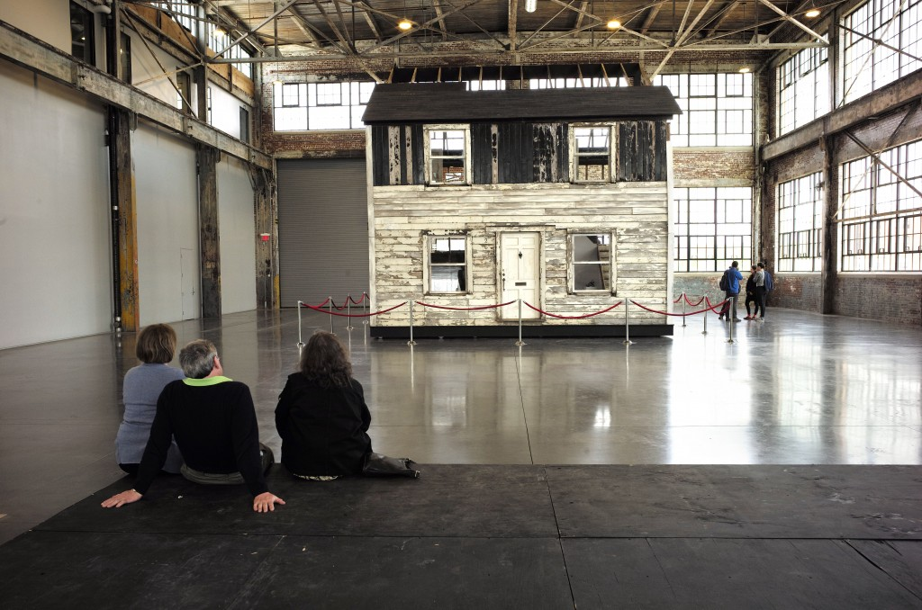 FILE - In this April 1, 2018 file photo, visitors view the rebuilt house of Rosa Parks at the WaterFire Arts Center in Providence, R.I. The house wher