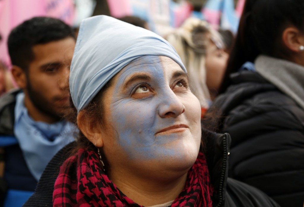 Pro-life protesters rally against a proposed law to legalize some abortion near Congress in Buenos Aires, Wednesday, June 13, 2018. Argentina's legisl
