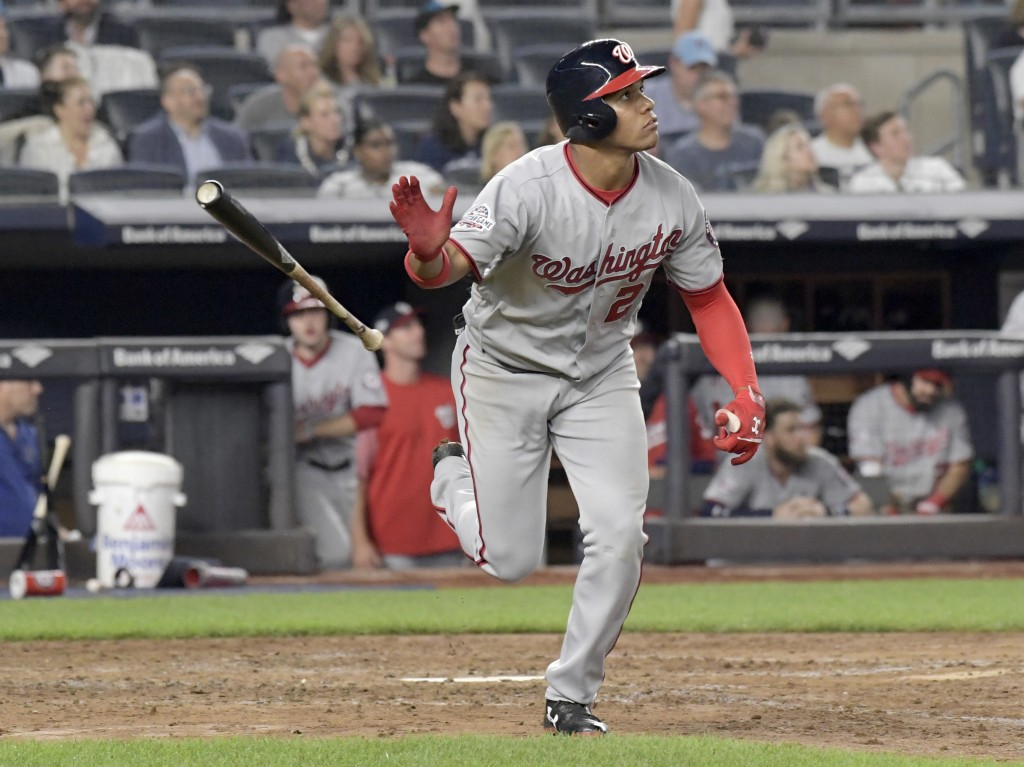 Washington Nationals' Juan Soto tosses his bat after hitting a home run against the New York Yankees during the seventh inning of a baseball game Wedn