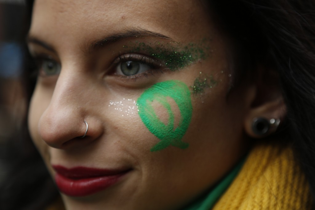 A pro-choice demonstrators participates in a concentration to support an abortion legalization law, near Argentina's congress in Buenos Aires, Wednesd