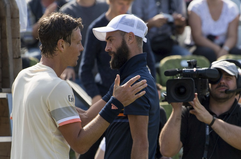 Tomas Berdych, left, Benoit Paire, right, after Berdych beats Paire at the ATP Mercedes Cup tournament in Stuttgart, Germany, Thursday, June 14, 2018.