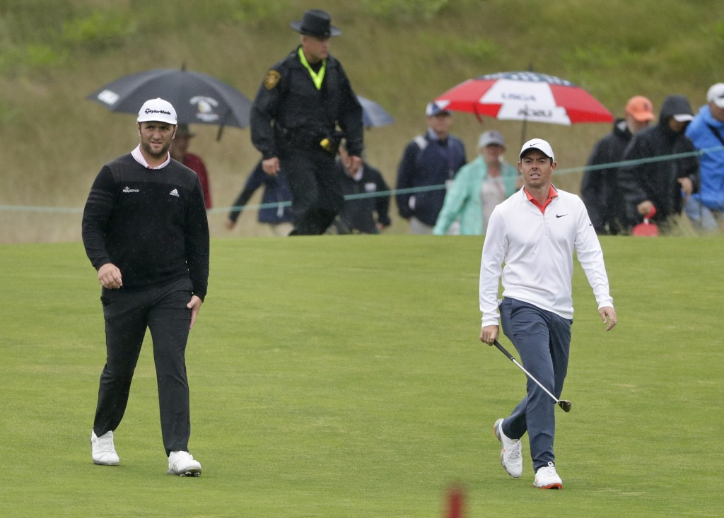 Jon Rahm, of Spain, left, walks with Rory McIlroy, of Northern Ireland, during a practice round for the U.S. Open Golf Championship, Wednesday, June 1