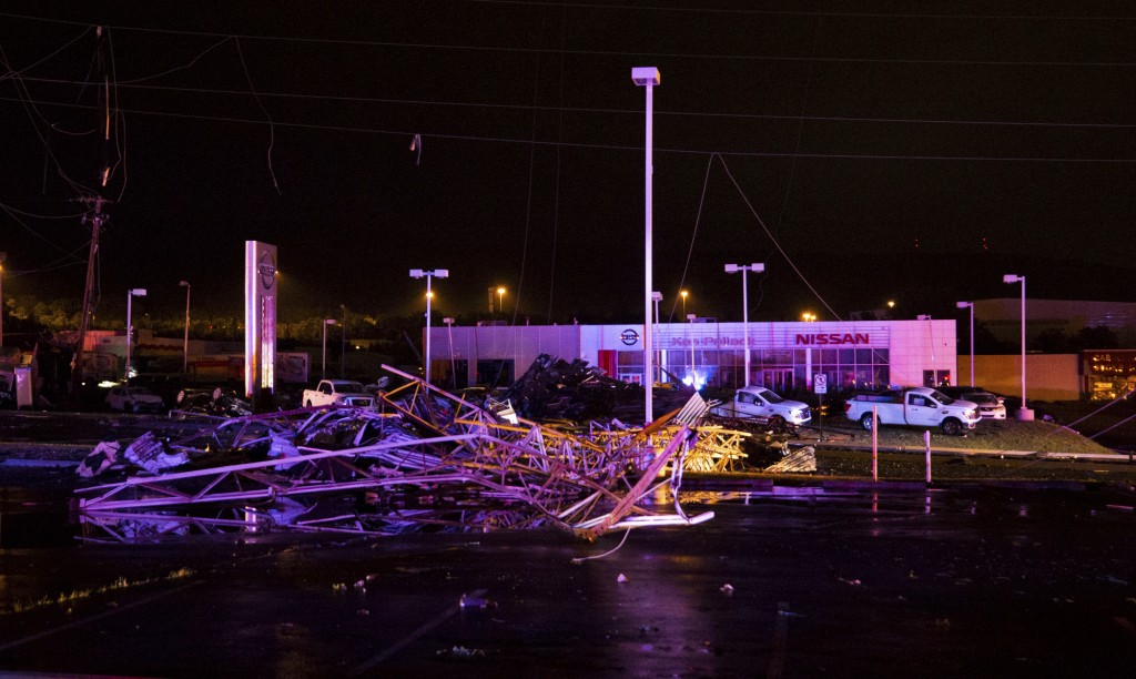 Debris is scattered in a parking lot near the Wyoming Valley Mall in Wilkes-Barre Township, Pa., after a powerful storm moved through the area on Wedn