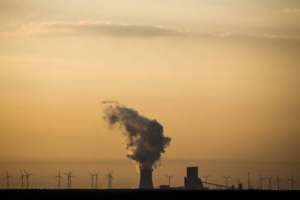 In this Tuesday, June 5, 2018 photo, steam rises in the air from the brown coal power plant Schwarze Pumpe in the Lusatia, (Lausitz) area in Germany.