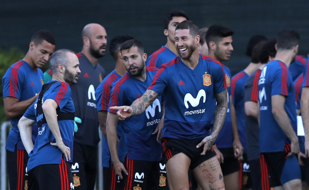 Spain's Sergio Ramos, center, jokes with his teammates during a training session of Spain at the 2018 soccer World Cup in Krasnodar, Russia, Wednesday