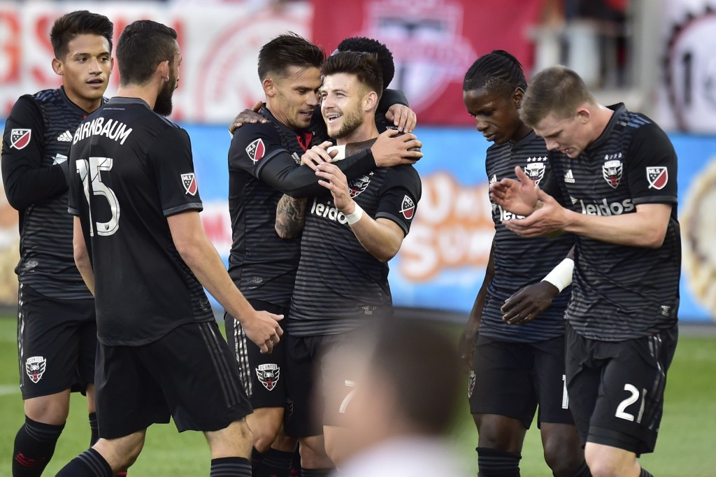 D.C. United forward Paul Arriola, center, celebrates his goal with teammates during the first half of an MLS soccer match against Toronto FC on Wednes