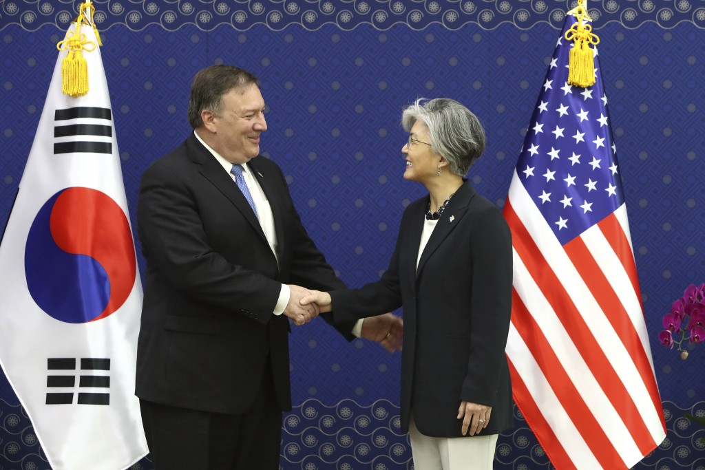 U.S. Secretary of State Mike Pompeo, left, shakes hands with South Korean Foreign Minister Kang Kyung-wha during their meeting at Foreign Ministry in