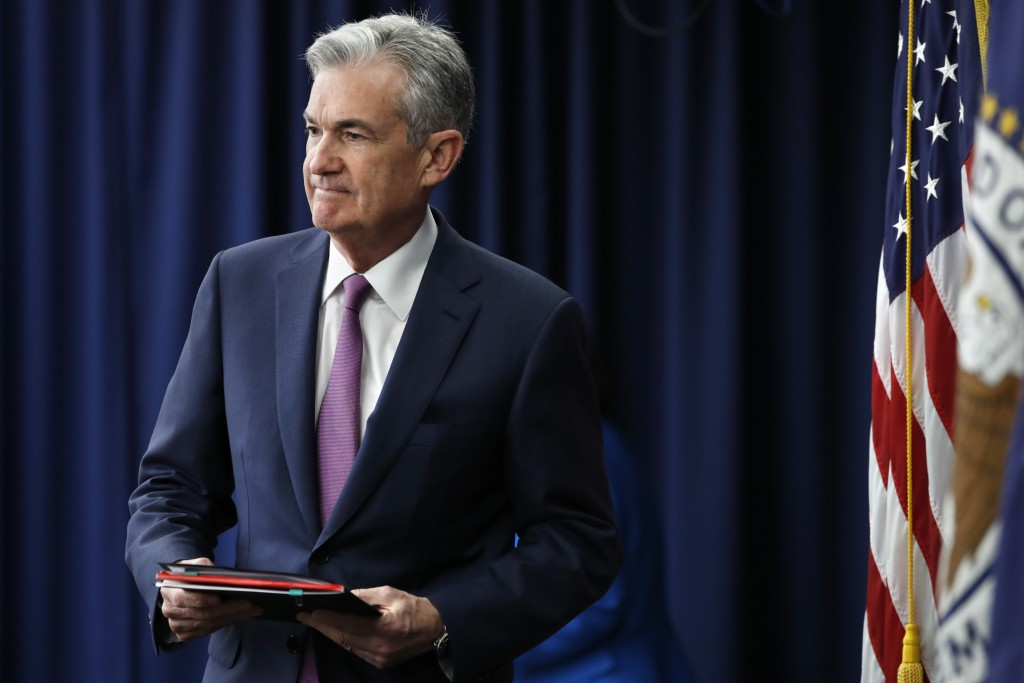 Federal Reserve Chair Jerome Powell arrives to a news conference after the Federal Open Market Committee meeting, Wednesday, June 13, 2018, in Washing
