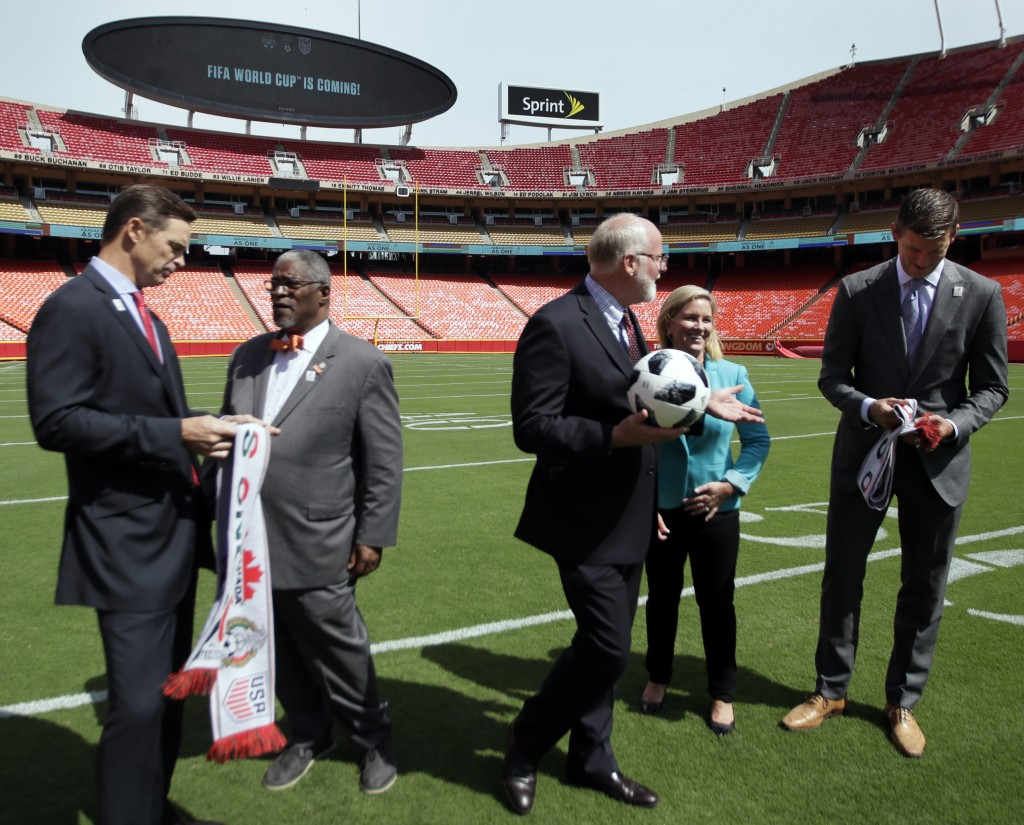Kansas City Chiefs president Mark Donovan, left, Kansas City Missouri Mayor Sly James, second from left, Kansas City Kansas Mayor David Alvey, middle,