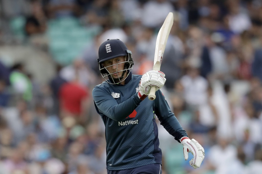 England's Joe Root swings his bat in frustration as he walks off the field of play after losing his wicket from the bowling of Australia's Billy Stanl