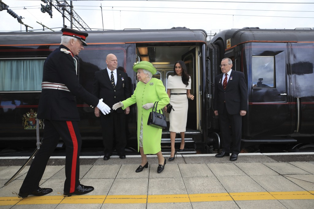 Britain's Queen Elizabeth II and Meghan, the Duchess of Sussex arrive by Royal Train at Runcorn Station, north west England, Thursday June 14, 2018. (