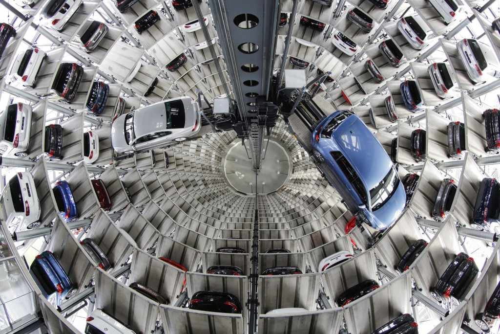 FILE - In this April 28, 2016 file photo Volkswagen cars are presented to media inside a delivery tower in Wolfsburg, Germany. Automaker Volkswagen sa
