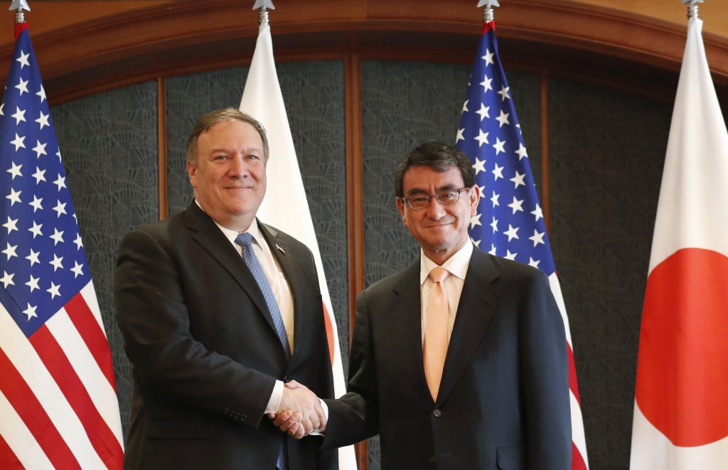 U.S. Secretary of State Mike Pompeo, left, poses with Japanese Foreign Minister Taro Kono for a photo during a bilateral meeting at a hotel in Seoul, ...