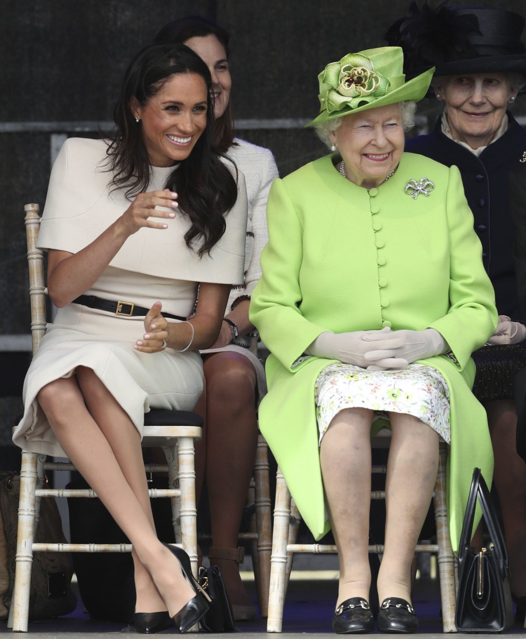 Britain's Queen Elizabeth II and Meghan, the Duchess of Sussex, left, attend the opening of the new Mersey Gateway Bridge, in Widnes, north west Engla