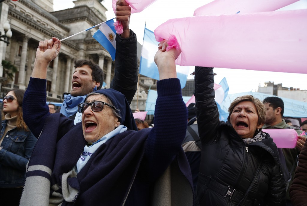 A nun attends a pro-life protest against a proposed law to legalize some abortion near Congress in Buenos Aires, Wednesday, June 13, 2018. Argentina's
