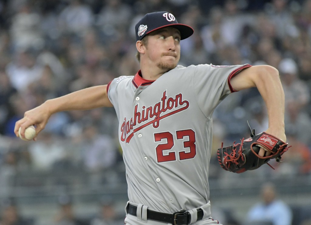 Washington Nationals pitcher Erick Fedde delivers the ball to the New York Yankees during the inning of a baseball game Wednesday, June 13, 2018, at Y