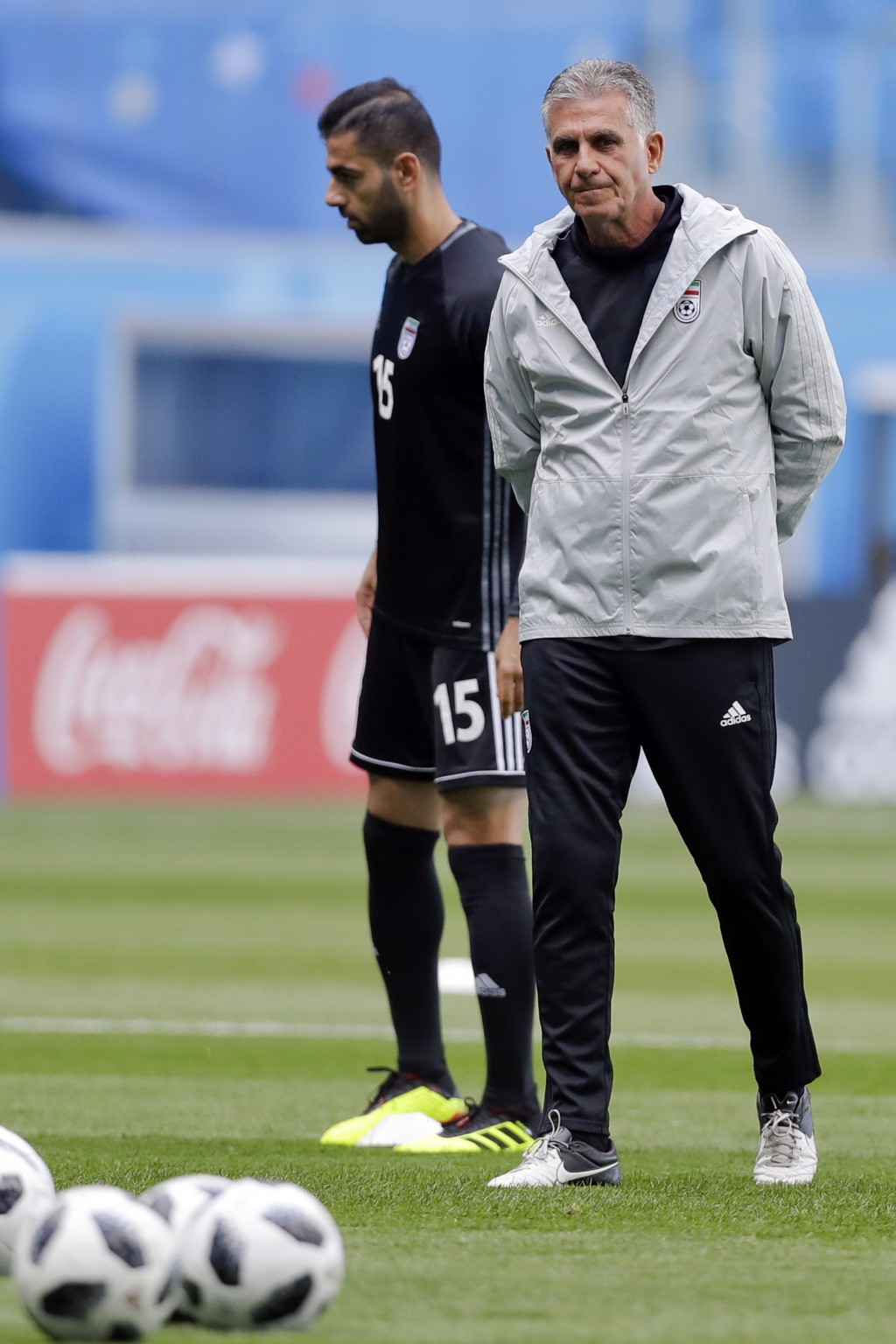Iran head coach Carlos Queiroz walks on the pitch during the official training of Iran on the eve of the group B match between Morocco and Iran at the