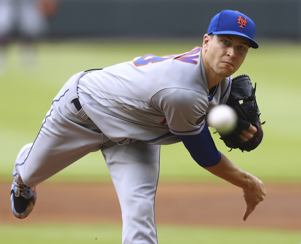 New York Mets pitcher Jacob deGrom throws against the Atlanta Braves during the first inning of a baseball game Wednesday, June 13, 2018, in Atlanta.