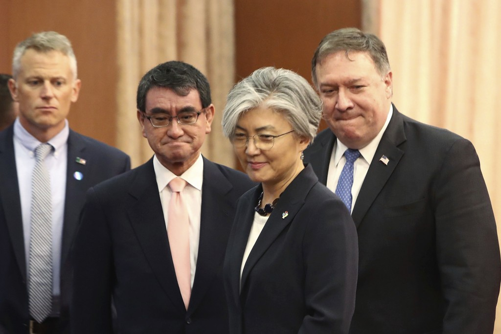 U.S. Secretary of State Mike Pompeo, right, attends a meeting with South Korean Foreign Minister Kang Kyung-wha, second from right, and Japanese Forei...