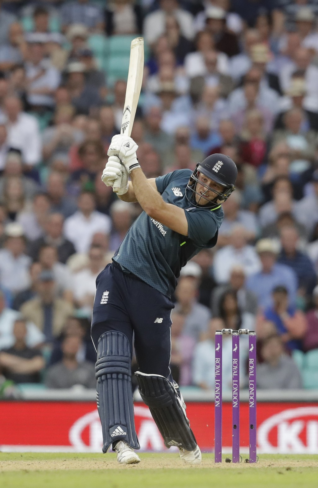 England's David Willey hits a six to win the match during the one-day cricket match between England and Australia at the Oval cricket ground in London