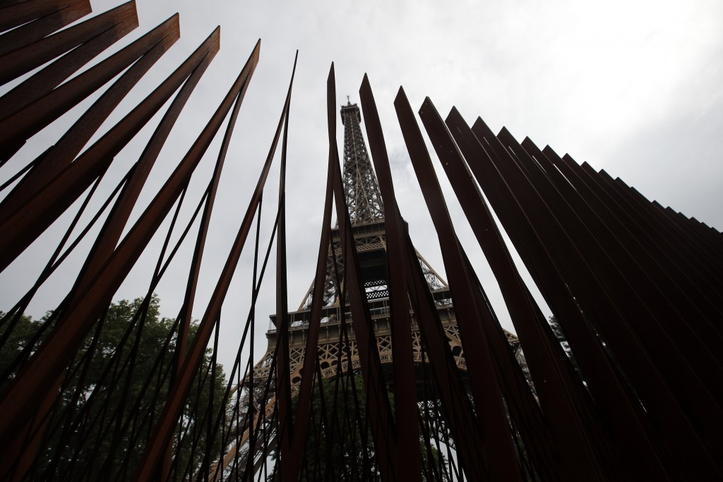 View of a new metal barrier under construction around the Eiffel Tower in Paris, France, Thursday, June 14, 2018. Paris authorities have started repla