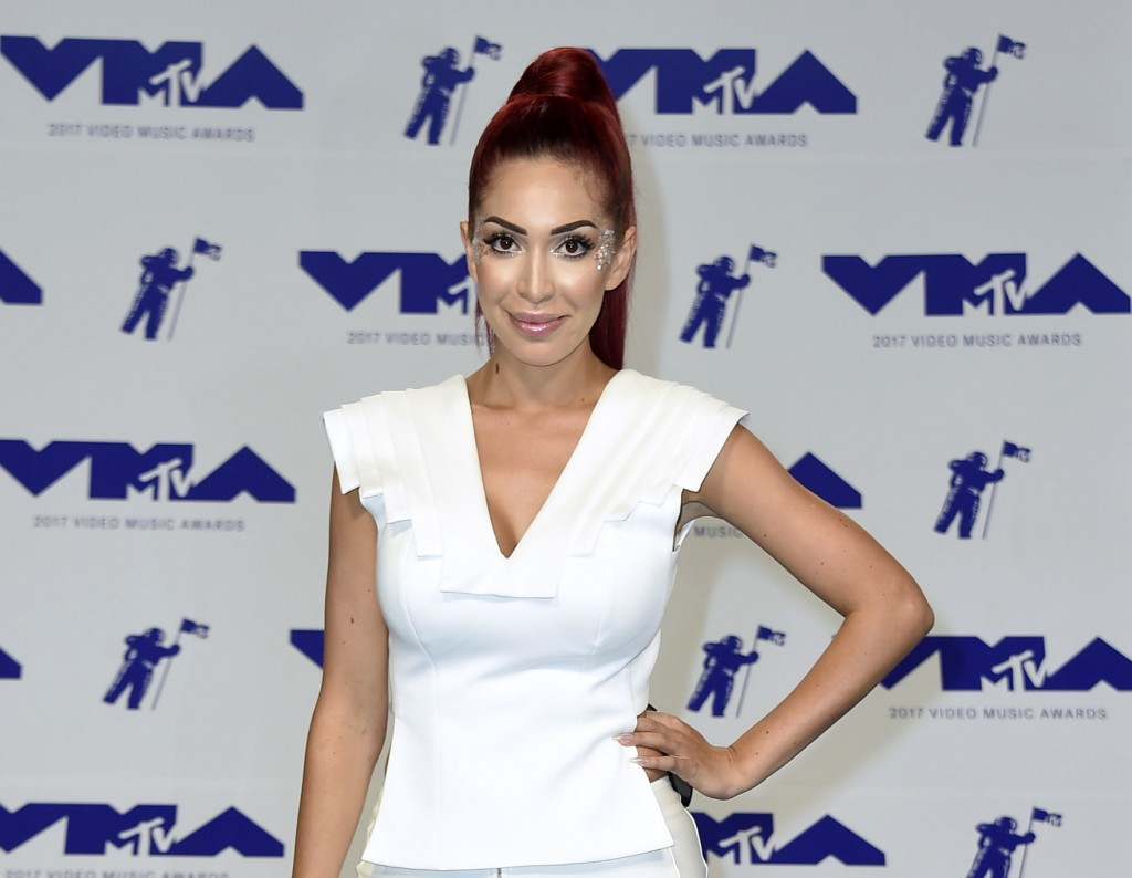 FILE - In this Aug. 27, 2017 file photo, Farrah Abraham arrives at the MTV Video Music Awards in Inglewood, Calif. Police say the former reality TV st