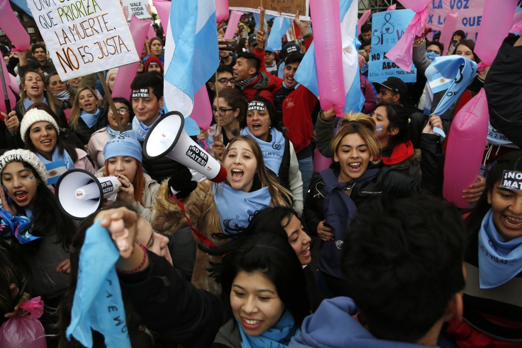 Pro-life youth protest against a proposed law to legalize some abortion near Congress in Buenos Aires, Wednesday, June 13, 2018. Argentina's legislatu