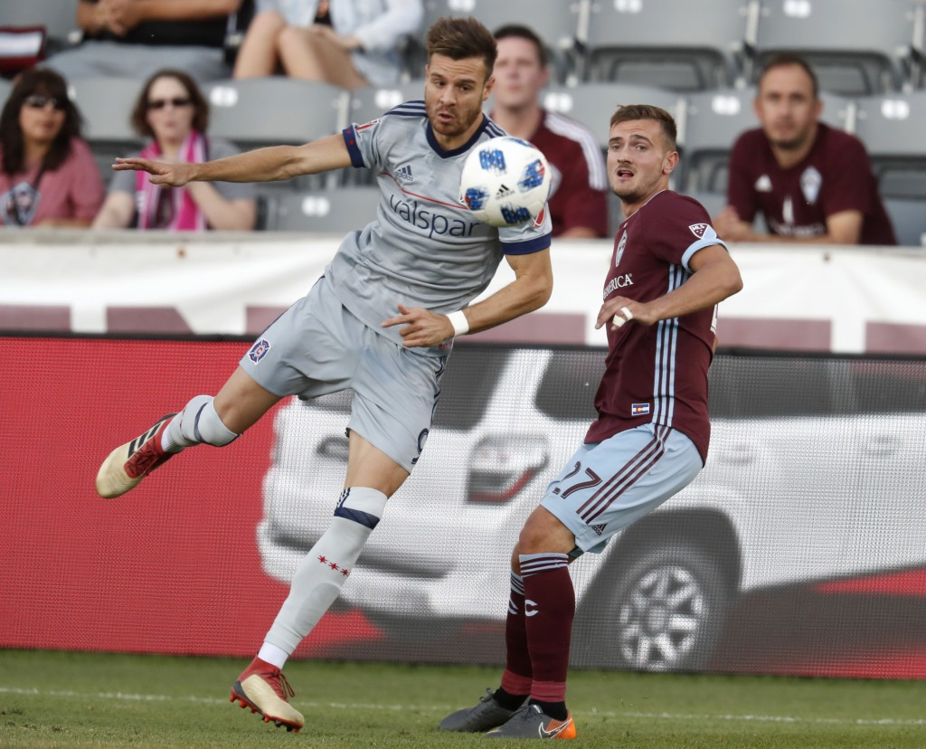 Chicago Fire forward Luis Solignac, left, pursues the ball with Colorado Rapids defender Deklan Wynne during the first half of an MLS soccer match Wed