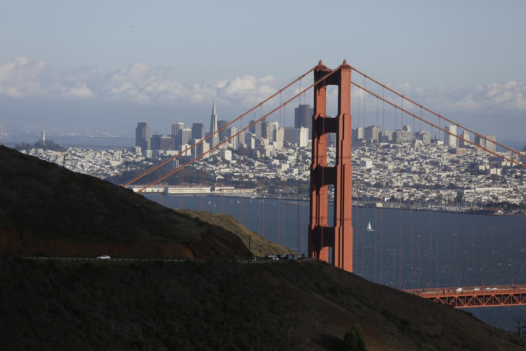 FILE- This Oct. 28, 2015, file photo shows the Golden Gate Bridge and San Francisco skyline from the Marin Headlands above Sausalito, Calif. An initia