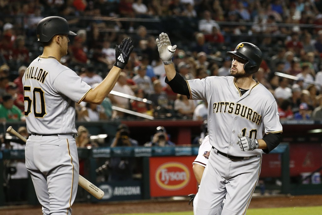 Pittsburgh Pirates' Jordy Mercer, right, celebrates his home run against the Arizona Diamondbacks with Jameson Taillon (50) during the fourth inning o...