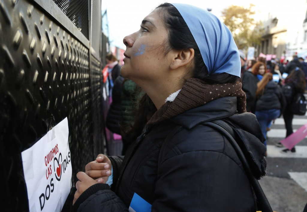 A nun prays during a pro-life protest against a proposed law to legalize some abortion near Congress in Buenos Aires, Wednesday, June 13, 2018. Argent