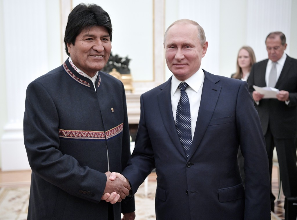 Russian President Vladimir Putin, right, shakes hands with Bolivia's President Evo Morales prior to their talks in Moscow, Russia, Wednesday, June 13,