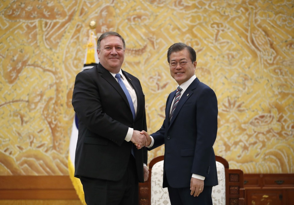 U.S. Secretary of State Mike Pompeo, left, poses with South Korean President Moon Jae-in for a photo during a bilateral meeting at the presidential Bl