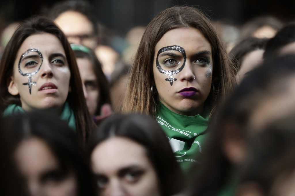 Pro-choice demonstrators participate in a concentration to support an abortion legalization law, near Argentina's congress in Buenos Aires, Wednesday,