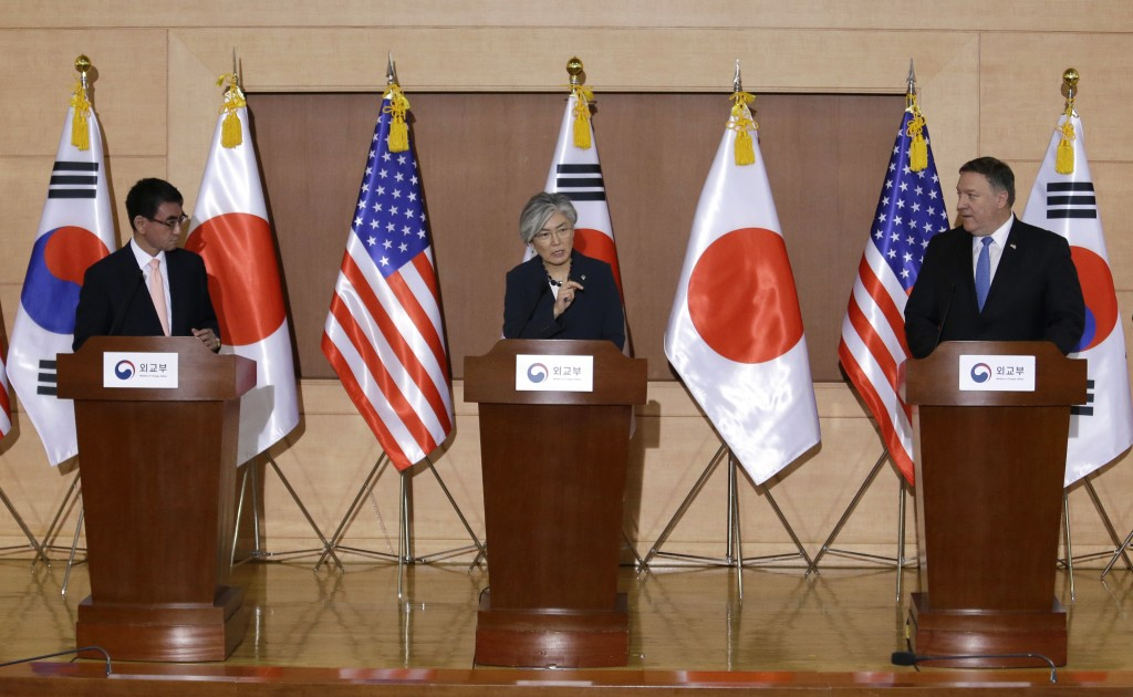 South Korean Foreign Minister Kang Kyung-wha, center, speaks as U.S. Secretary of State Mike Pompeo, right, and Japanese Foreign Minister Taro Kono li