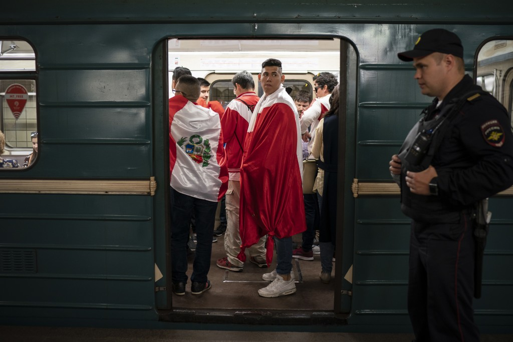 Soccer fans ride in the metro near the Luzhniki stadium before the group A match between Russia and Saudi Arabia which opens the 2018 soccer World Cup