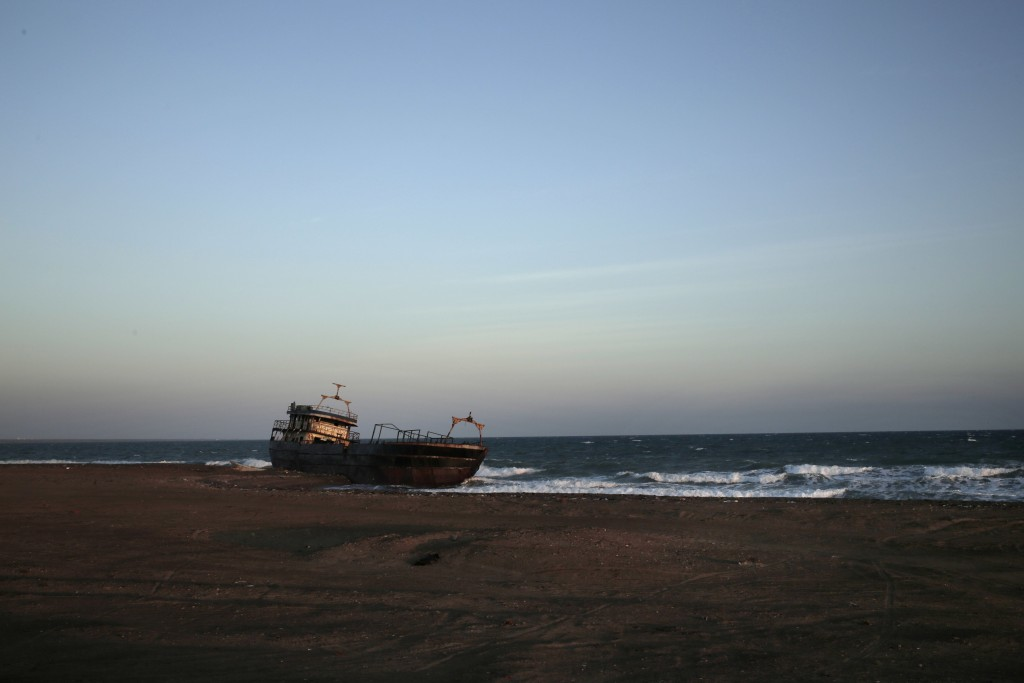This Feb. 10, 2018, photo shows a ship wreck abandoned on the shore from Mocha to Aden in Yemen. On the beach, old pleasure venues also lie empty, bro